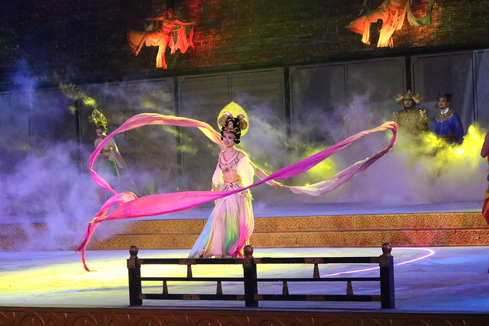 A woman dancing with long ribbon-like sleeves