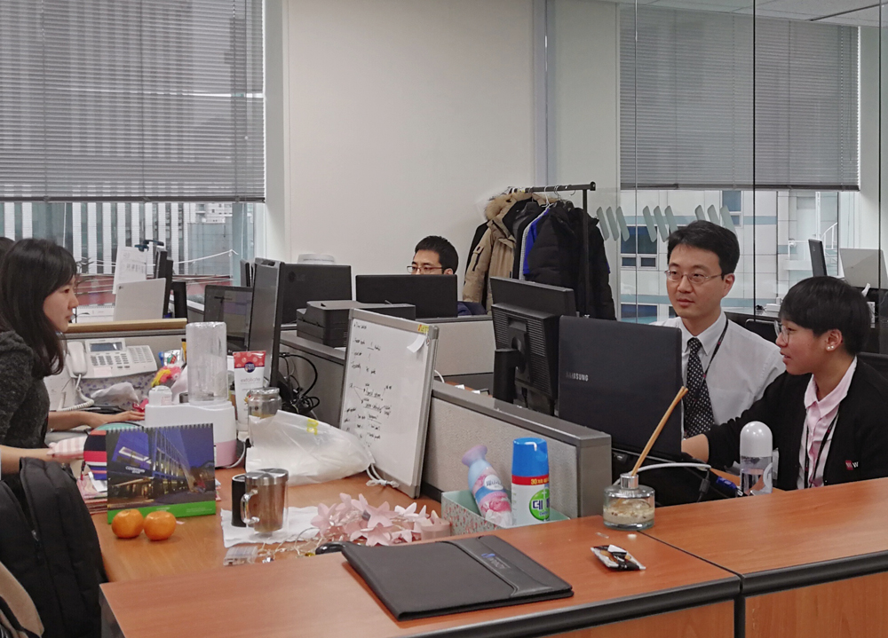 office workers sitting at their desks working hard