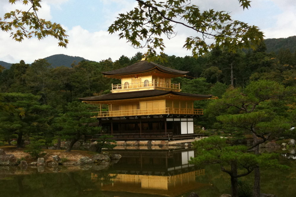 Japanese pavilion on the water in golden colours