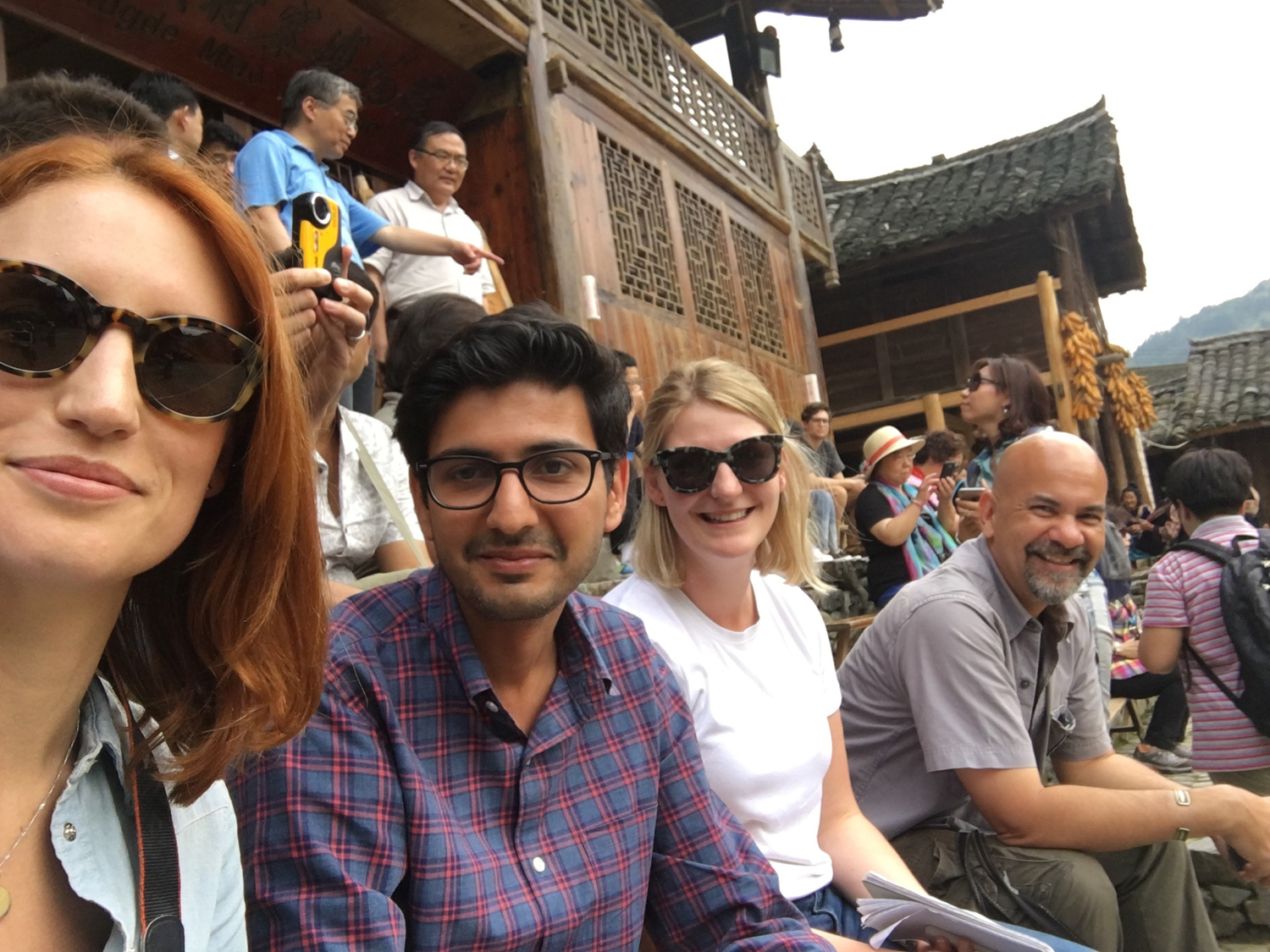 Samantha Hayes and fellow Jefferson Fellowship participants sitting outside with a traditional Chinese building behind them
