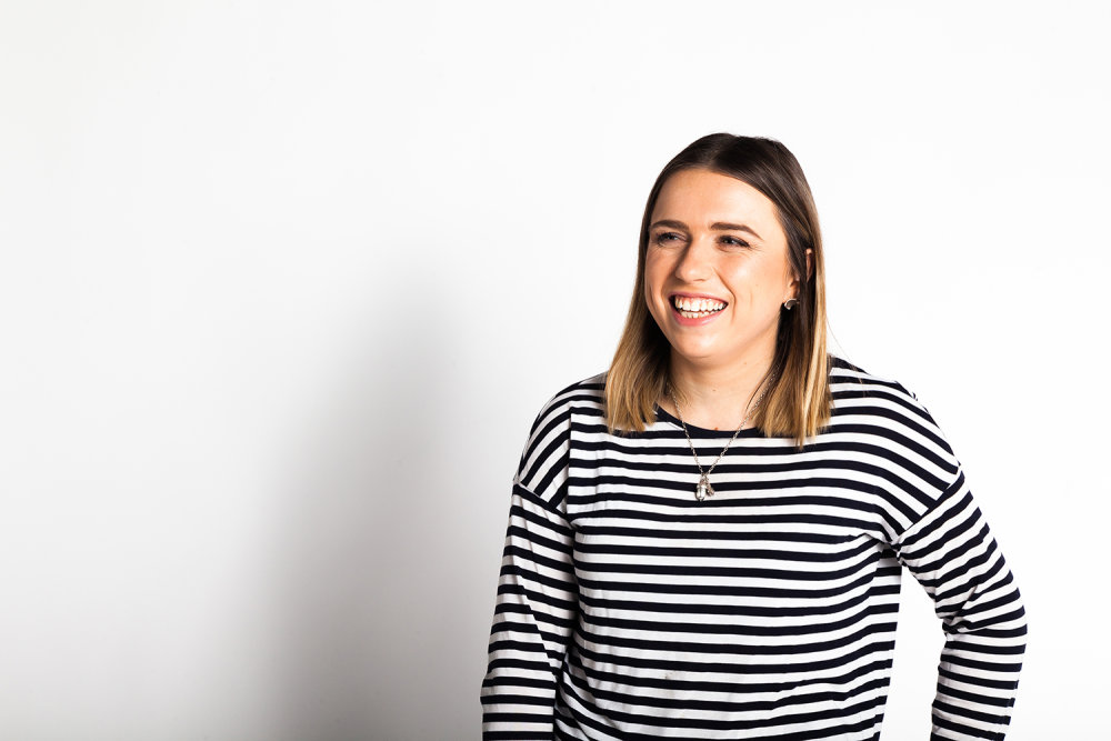 Photo of Amelia Morgan in a striped t-shirt against a white background