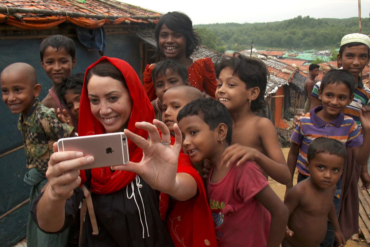 Sunday reporter Miriama Kamo taking a selfie with a group of children
