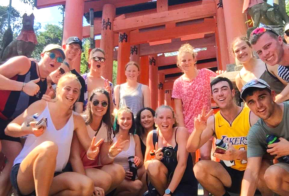 The rowers posing beneath Torii Gates (Photo courtesy of Rowing NZ)