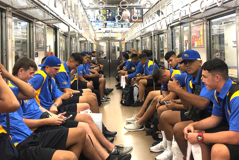 The team sitting in a subway carriage