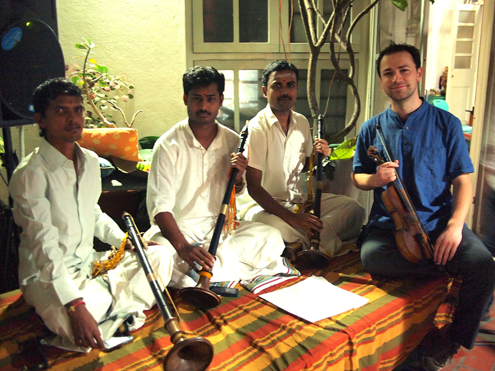 Sanjeev, Srinivas, Santosh and Tristan sitting with their instruments at 1Shanthi Rd Artist Residency