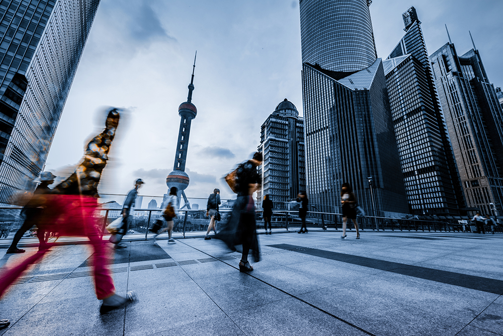 People walking in front of Shanghai's Orient Pearl Building