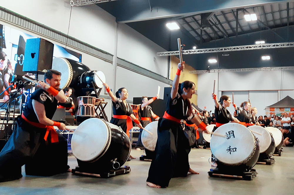 A group of taiko drummers drumming